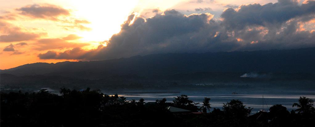 Sunrise over the Cebu hills seen from Turtle Bay Dive Resort