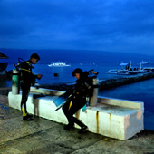 Preparing for a night dive on the house reef