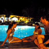 Enjoy a poolside drink with new friends