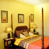 A clean and spacious deluxe room with ensuite bathroom