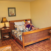 A deluxe family room with a queen bed and a single bed